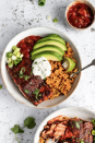 """<p>This small-batch recipe is packed with big flavor. The perfectly flaked salmon is coated in a homemade taco seasoning that includes coconut sugar and spices like cumin, chili powder, and cayenne. </p><p><strong>Get the recipe at <a href=""""https://www.ambitiouskitchen.com/wp-content/uploads/2019/12/Damn-Good-Salmon-Taco-Bowls-5.jpg"""" rel=""""nofollow noopener"""" target=""""_blank"""" data-ylk=""""slk:Ambitious Kitchen"""" class=""""link rapid-noclick-resp"""">Ambitious Kitchen</a>.</strong> </p>"""