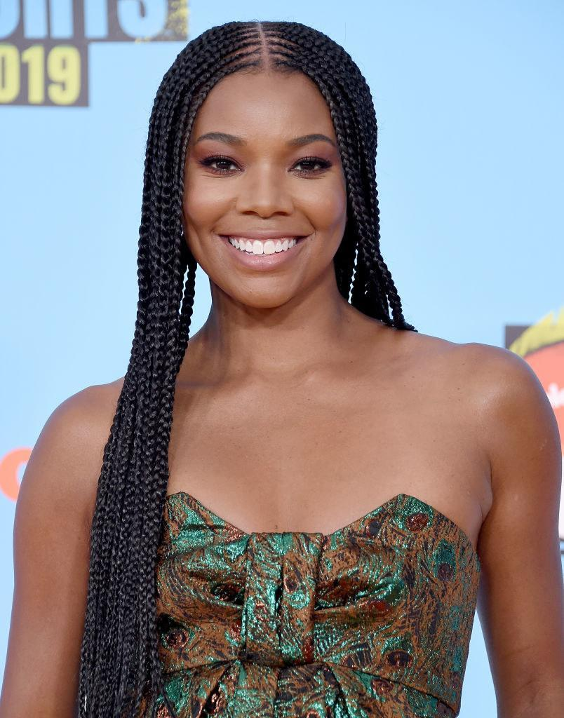 Gabrielle wearing a textured strapless outfit at an event