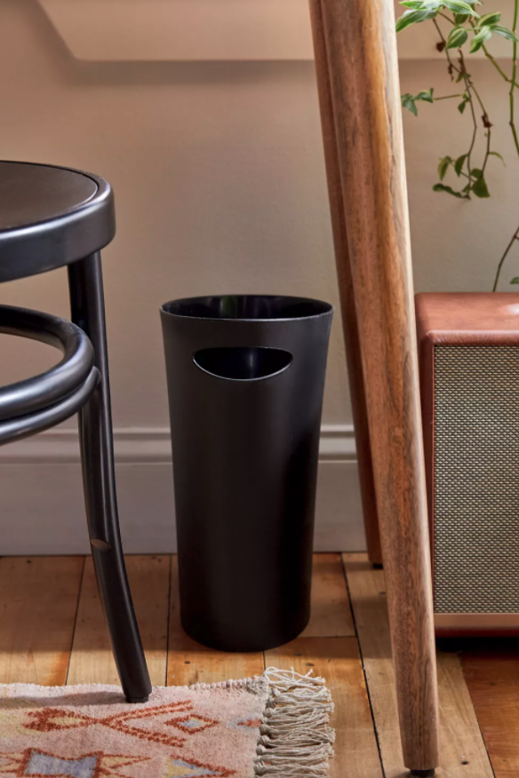 "<h3><a href=""https://www.urbanoutfitters.com/shop/umbra-tristian-skinny-trash-can"" rel=""nofollow noopener"" target=""_blank"" data-ylk=""slk:Umbra Tristian Skinny Trash Can"" class=""link rapid-noclick-resp"">Umbra Tristian Skinny Trash Can</a></h3><br><strong>When there's no available area to hide the bin under: </strong>This clever trash receptacle boasts a ""skinny"" frame and minimalist matte-black sheen that you can discretely tuck in tight spaces. <br><br><strong>Umbra</strong> Tristian Skinny Trash Can, $, available at <a href=""https://go.skimresources.com/?id=30283X879131&url=https%3A%2F%2Fwww.urbanoutfitters.com%2Fshop%2Fumbra-tristian-skinny-trash-can"" rel=""nofollow noopener"" target=""_blank"" data-ylk=""slk:Urban Outfitters"" class=""link rapid-noclick-resp"">Urban Outfitters</a>"