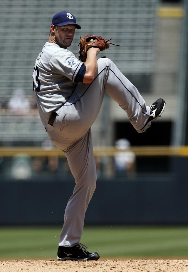San Diego Padres starting pitcher Eric Stults throws to the plate against the Colorado Rockies during the first inning of a baseball game on Wednesday, July 9, 2014, in Denver. (AP Photo/Jack Dempsey)