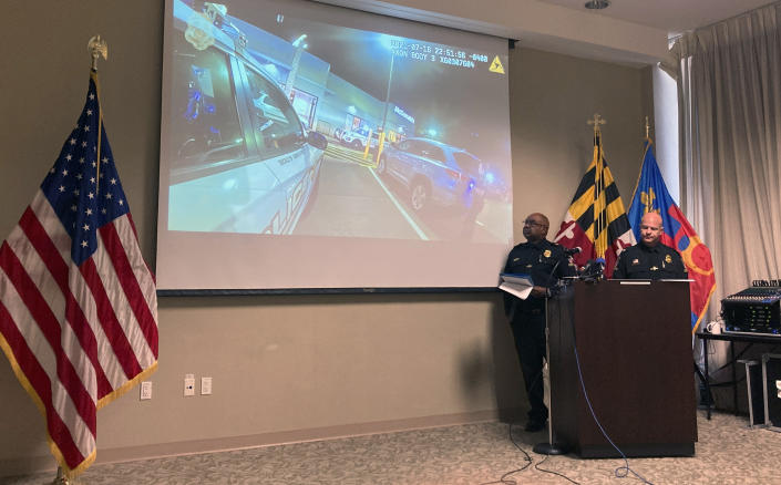 Montgomery County Police Chief Marcus Jones, left, and Assistant Police Chief Darren Francke review an officers' body camera footage from a fatal police shooting on July 16 at a McDonald's in Gaithersburg, Md., during a news conference in Gaithersburg, Tuesday, July 27, 2021. (AP Photo/Michael Kunzelman)