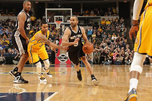 INDIANAPOLIS - MARCH 31: Tony Parker #9 of the San Antonio Spurs drives to the basket against the Indiana Pacers at Bankers Life Fieldhouse on March 31, 2014 in Indianapolis, Indiana. (Photo by Ron Hoskins/NBAE via Getty Images)