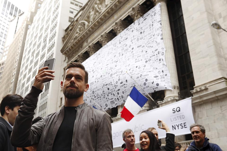 Jack Dorsey, CEO of Square and CEO of Twitter, uses his phone to live cast during an event outside of the New York Stock Exchange to celebrate the IPO of Square Inc., in New York November 19, 2015. Square Inc priced shares at $9 for its initial public offering, about 25 percent less than it had hoped, as it struggled to win over investors skeptical about its business and valuation before trading begins on Thursday.  REUTERS/Lucas Jackson