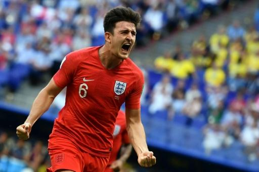 England defender Harry Maguire celebrates after scoring the opening goal in the World Cup quarter-final against Sweden in Samara
