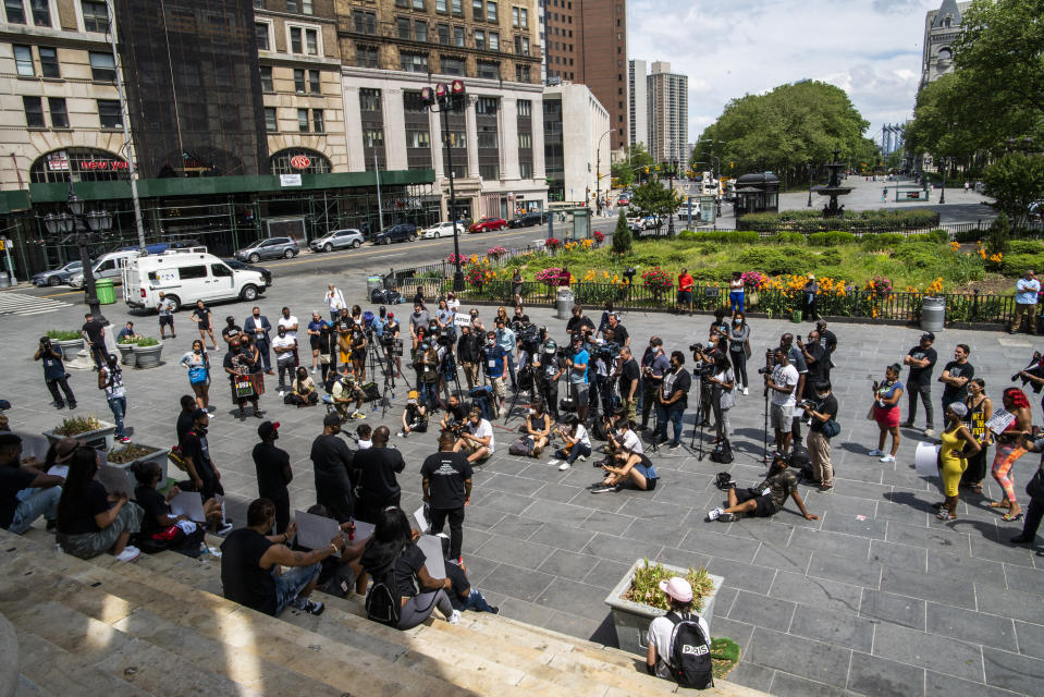 People attend a rally with Terrence Floyd, brother of George Floyd, on Sunday, May 23, 2021, in Brooklyn borough of New York. George Floyd, whose May 25, 2020 death in Minneapolis was captured on video, plead for air as he was pinned under the knee of former officer Derek Chauvin, who was convicted of murder and manslaughter in April 2021. (AP Photo/Eduardo Munoz Alvarez)