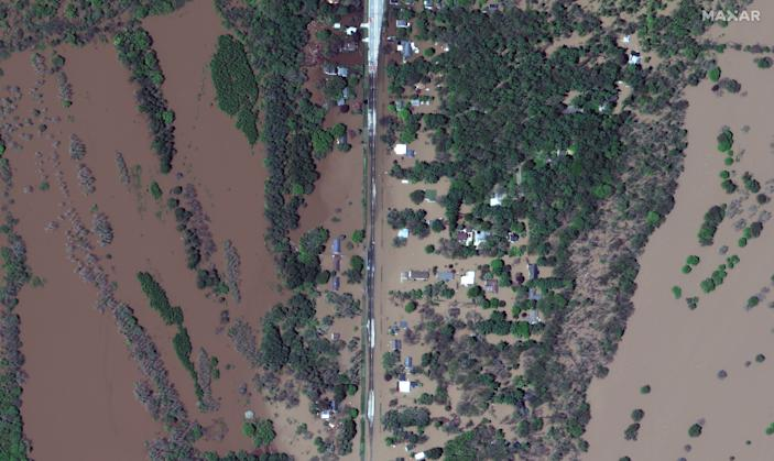 A satellite image shows the flooded Isabella Street and homes after rising floodwaters unleashed by two dam failures submerged parts of Midland, Michigan