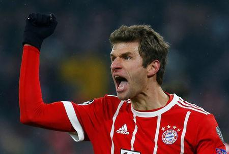 Soccer Football - Champions League Round of 16 First Leg - Bayern Munich vs Besiktas - Allianz Arena, Munich, Germany - February 20, 2018 Bayern Munich's Thomas Muller celebrates scoring their third goal REUTERS/Ralph Orlowski
