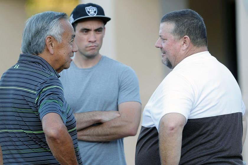 Norm Chow, the former offensive coordinator for USC and UCLA, talks with St. Francis' head coach Jim Bonds before the start of the season home opener non-league football game at St. Francis on Friedman Field on Friday, August 30, 2019.