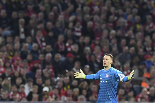 Bayern goalkeeper Manuel Neuer reacts during the German Bundesliga soccer match between FC Bayern Munich and Borussia Dortmund in the Allianz Arena in Munich, Germany, on Saturday, April 6, 2019. (AP Photo/Kerstin Joensson)