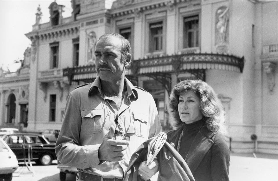 British actor Sean Connery  and his wife, Micheline, are shown in front of the Monte Carlo casino in Monaco, in the South of France, April 27, 1977.  (AP Photo/Rene Maestri)