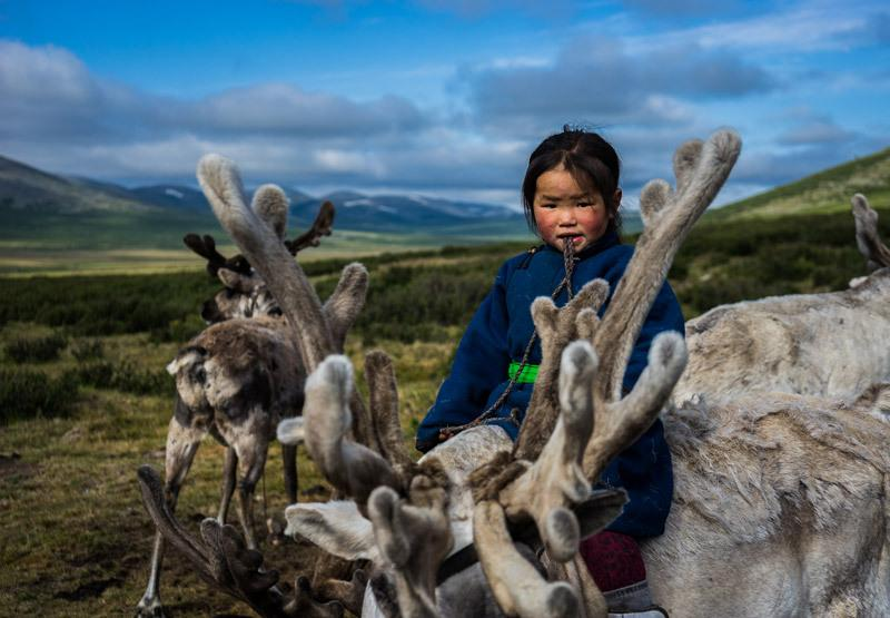 "<p>With no forms of modern entertainment, the Dukha people live a life of simplicity and necessity. For this three-year-old girl, riding a reindeer is not only fun, but also an important skill to learn. <i><br /></i></p><p><i>(Photo: Jarryd Salem/<a href=""http://www.nomadasaurus.com"">NOMADasaurus)</a></i> </p>"