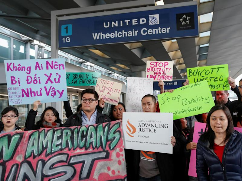 Protesters at O'Hare International Airport in Chicago, where doctor David Dao was forcibly removed from a United Airlines flight: Reuters