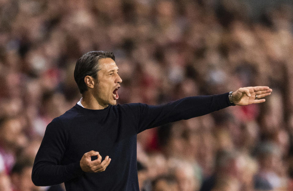 Munich's head coach Niko Kovac gestures to players during the German soccer cup, DFB Pokal, first Round match between FC Energie Cottbus and FC Bayern Munich in Cottbus, Germany, Monday, Aug. 12, 2019. (Robert Michael/dpa via AP)