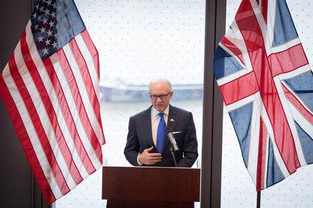 FILE PHOTO: United States ambassador to the Court of St James Woody Johnson speaks during a press preview at the new United States embassy building near the River Thames in London