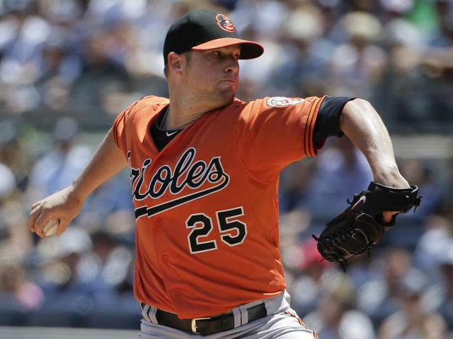 Baltimore Orioles pitcher Bud Norris delivers against the New York Yankees in the first inning of a baseball game, Saturday, June 21, 2014, in New York. (AP Photo/Julie Jacobson)