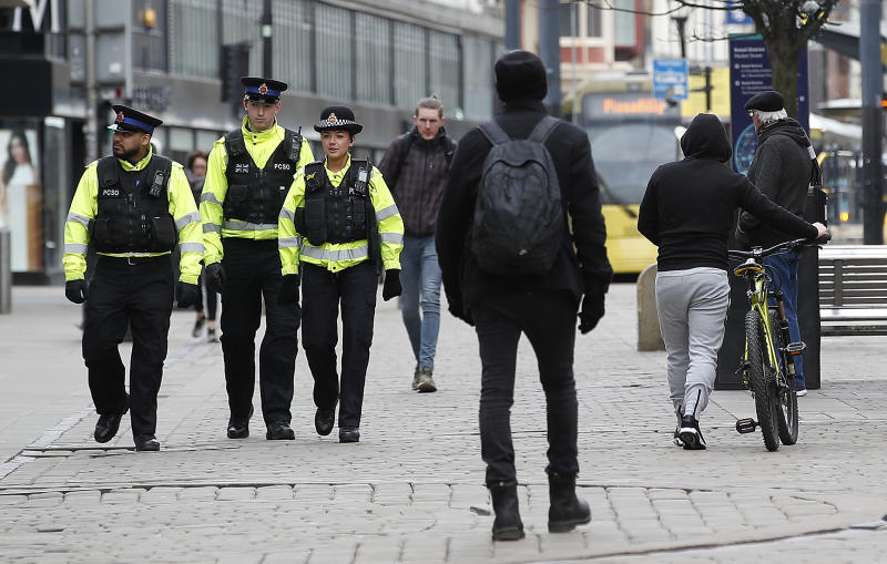 Police officers walk down Market Street, Manchester as the UK continues in lockdown to help curb the spread of the coronavirus. (Photo by Martin Rickett/PA Images via Getty Images)