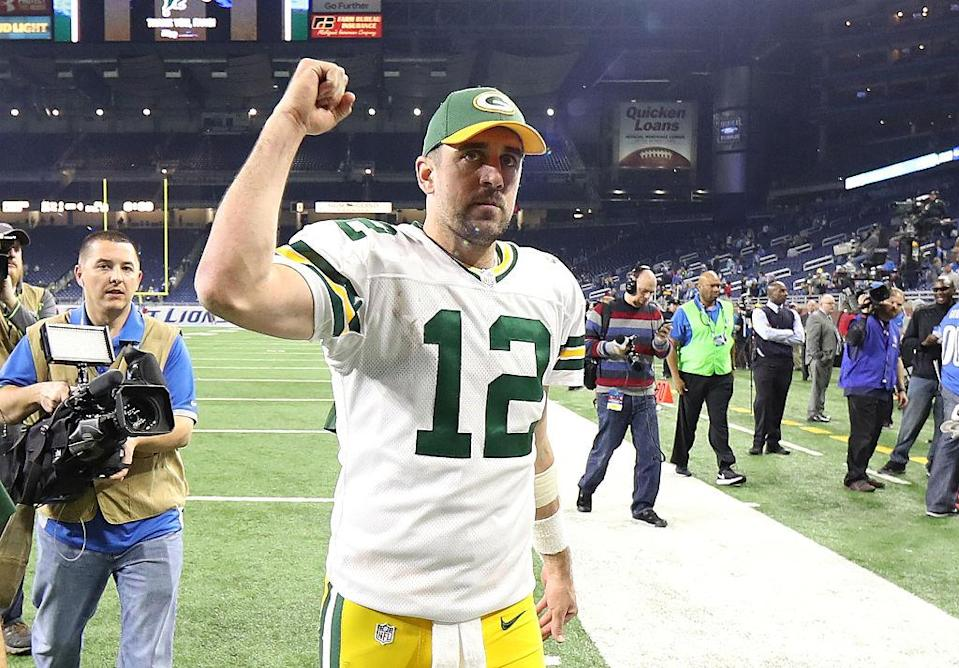 Aaron Rodgers threw for 300 yards and four TDs against the Lions. (Getty)