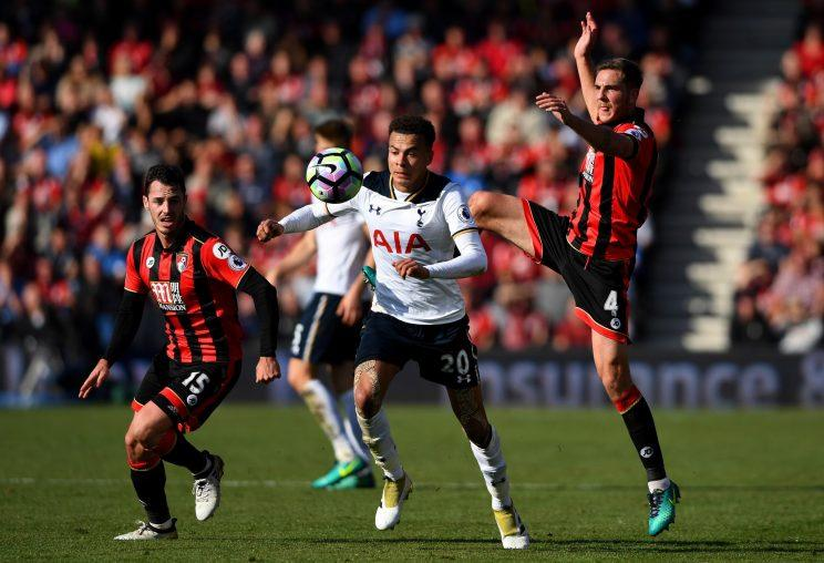 Dan Gosling of Bournemouth and Delle Alli compete for the ball