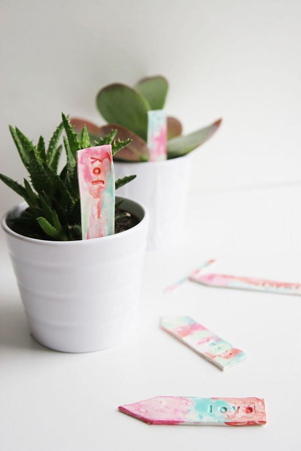 """<p>Acrylic paint, alphabet stamps, and oven-bake polymer clay are all you need to make these pretty plant markers with the kids.</p><p><strong>Get the tutorial at <a href=""""http://www.homemadeginger.com/2016/03/watercolor-plant-markers.html"""" rel=""""nofollow noopener"""" target=""""_blank"""" data-ylk=""""slk:Homemade Ginger"""" class=""""link rapid-noclick-resp"""">Homemade Ginger</a>. </strong></p>"""