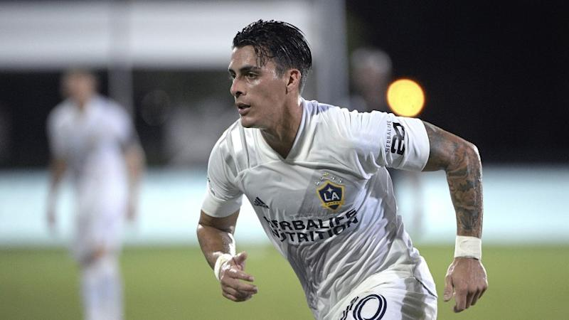 LA Galaxy forward Cristian Pavon (10) follows a play during the first half of an MLS soccer match against the Los Angeles FC, Saturday, July 18, 2020, in Kissimmee, Fla. (AP Photo/Phelan M. Ebenhack)