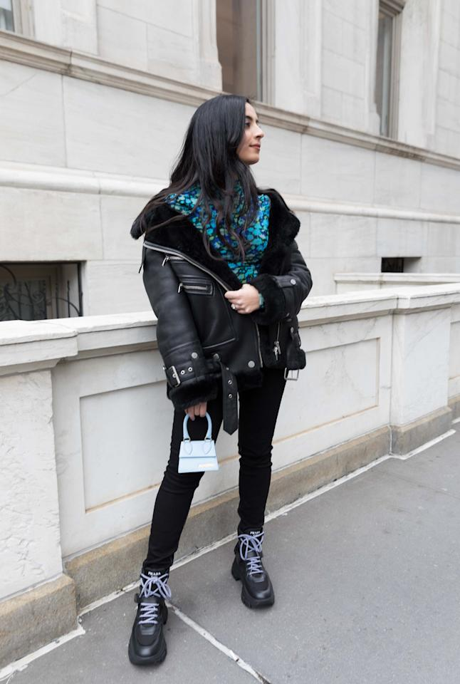 <p>I styled my baby-blue Jacquemus bag with a printed Ganni turtleneck, an Arrivals leather jacket, and chunky Prada combat boots.</p>