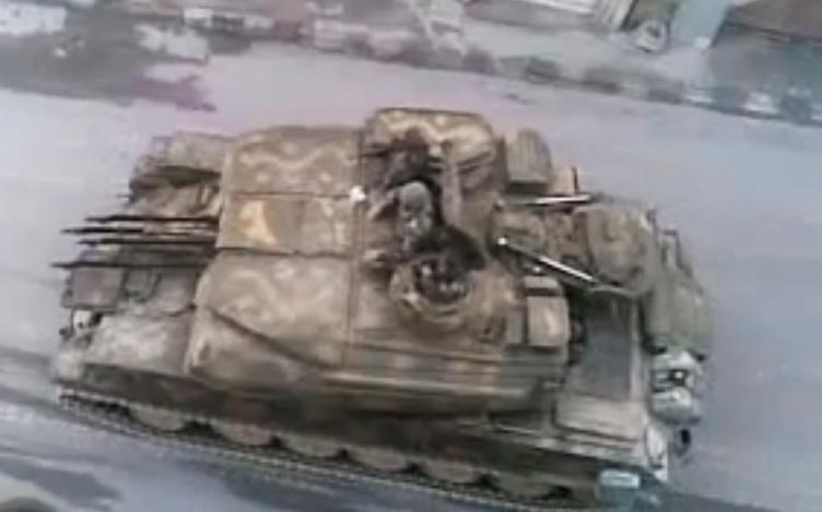 "In this image made from amateur video released by the Shaam News Network and accessed Monday, May 28, 2012, purports to show a Syrian military tank in Damascus, Syria. U.N. envoy Kofi Annan called Monday on ""every individual with a gun"" in Syria to lay down arms, saying he was horrified by a weekend massacre that killed more than 100 people, including women and small children. (AP Photo/Shaam News Network via AP video) TV OUT, THE ASSOCIATED PRESS CANNOT INDEPENDENTLY VERIFY THE CONTENT, DATE, LOCATION OR AUTHENTICITY OF THIS MATERIAL"
