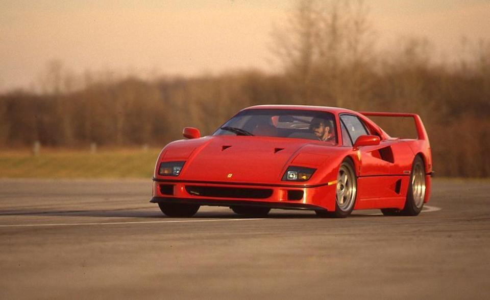 """<p>It also was fundamentally the last """"conventional"""" super Ferrari, if a super Ferrari can be conventional. The F50 threw all sorts of Formula 1–derived wackiness at the concept. The Enzo followed a similar line of thinking. The LaFerrari is a hybrid. The F40, on the other hand, was a steel-tube chassis with a lightweight body draped over it. A twin-turbocharged 2.9-liter V-8 cranking out 478 horsepower spun and whooshed behind the driver's head. <a href=""""http://www.caranddriver.com/reviews/ferrari-f40-archived-instrumented-test-review"""" rel=""""nofollow noopener"""" target=""""_blank"""" data-ylk=""""slk:In our testing"""" class=""""link rapid-noclick-resp"""">In our testing</a>, it ran 122 mph through the quarter-mile. The last Z06 we tested went 126 in the same distance. That is a testament to the Corvette's goodness. That it takes a 650-hp Corvette with a 30-year technological advantage to outrun the Ferrari is a testament to how absolutely astounding the F40 was—and still is. <em>—Davey G. Johnson</em></p>"""