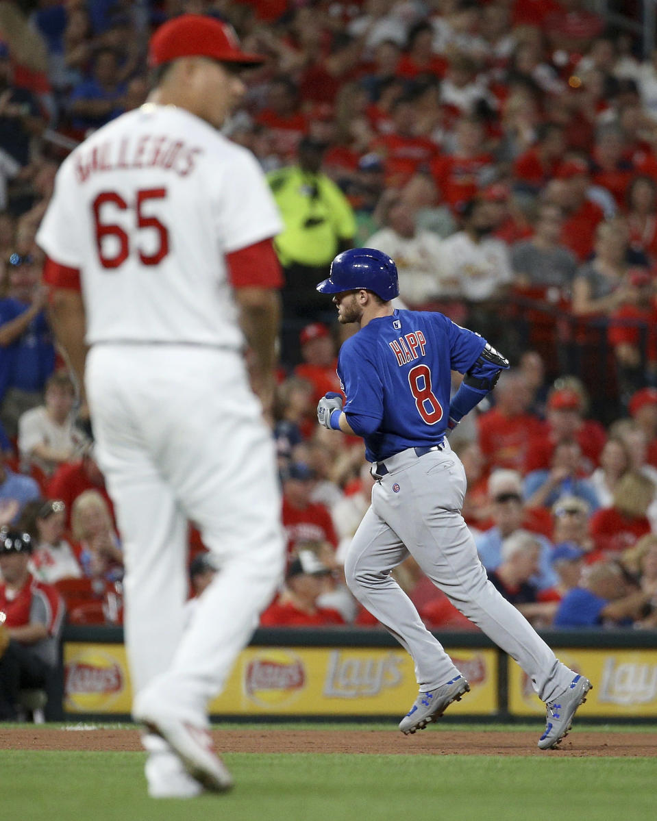 Chicago Cubs' Ian Happ (8) runs the bases after hitting a solo home run off St. Louis Cardinals relief pitcher Giovanny Gallegos (65) during the sixth inning of a baseball game Friday, Sept. 27, 2019, in St. Louis. (AP Photo/Scott Kane)