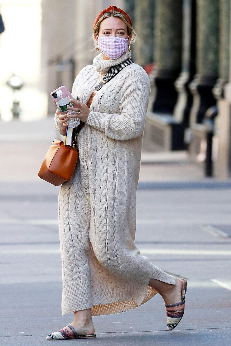 <p>Hilary Duff wore a tan knit sweater dress on her walk through N.Y.C. on Saturday.</p>