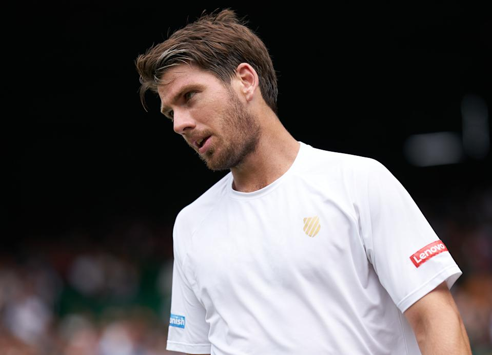 Cameron Norrie sees a chance go wide while playing Roger Federer on Centre Court in the men's third round at the All England Lawn Tennis club.