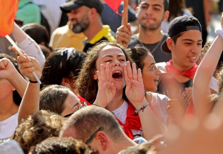 Lebanese students wave the national flag and chant slogans (AFP Photo/ANWAR AMRO)