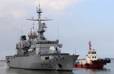 FILE PHOTO: A tugboat escorts French Navy frigate Vendemiaire on arrival for a goodwill visit at a port in Metro Manila
