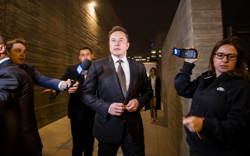 Elon Musk outside court earlier this week - Getty Images North America