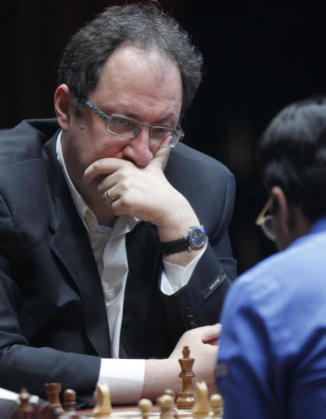 Boris Gelfand of Israel, left, contemplates his next move during a match against World Chess champion Viswanathan Anand from India at the FIDE World Chess Championship tie break match at Moscow's Tretyakovsky State Gallery, Russia, Wednesday, May 30, 2012. (AP Photo/Misha Japaridze)