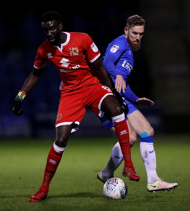 "Soccer Football - League One - Gillingham vs Milton Keynes Dons - MEMS Priestfield Stadium, Gillingham, Britain - March 29, 2018 Gillingham's Scott Wagstaff in action with MK Dons' Ousseynou Cisse Action Images/Peter Cziborra EDITORIAL USE ONLY. No use with unauthorized audio, video, data, fixture lists, club/league logos or ""live"" services. Online in-match use limited to 75 images, no video emulation. No use in betting, games or single club/league/player publications. Please contact your account representative for further details."