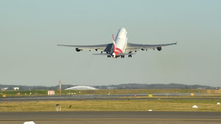 A Qantas 747 takes off from Sydney for a final flight to Mojave