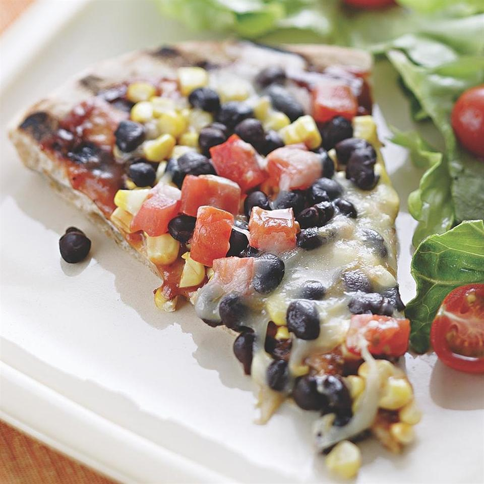 <p>The secret to a grilled pizza is having all your ingredients ready to go before you head out to the grill. Make it a meal: Toss the extra black beans, diced tomato and some avocado with prewashed salad greens and a tangy vinaigrette and dinner is on the table in no time.</p>