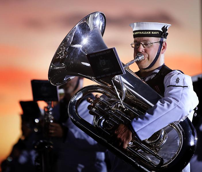 A member of the Royal Australian Navy Band plays at the Ceremonial Sunset held at ANZAC Peace Park, as part of the Albany Convoy Commemorative Event, on October 31, 2014 (AFP Photo/Abis Bonny Gassner)