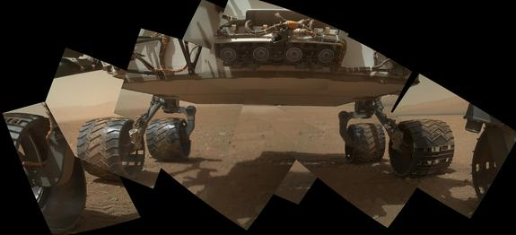 This view of the lower front and underbelly areas of NASA's Mars rover Curiosity combines nine images taken by the rover's Mars Hand Lens Imager (MAHLI) during the 34th Martian day, or sol, of Curiosity's work on Mars (Sept. 9, 2012).