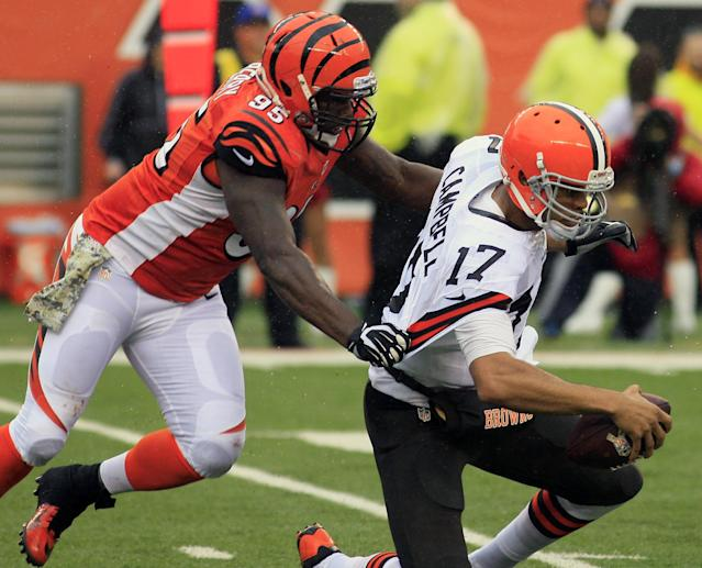 Cincinnati Bengals defensive end Wallace Gilberry sacks Cleveland Browns quarterback Jason Campbell (17) in the second half of an NFL football game, Sunday, Nov. 17, 2013, in Cincinnati. (AP Photo/Tom Uhlman)