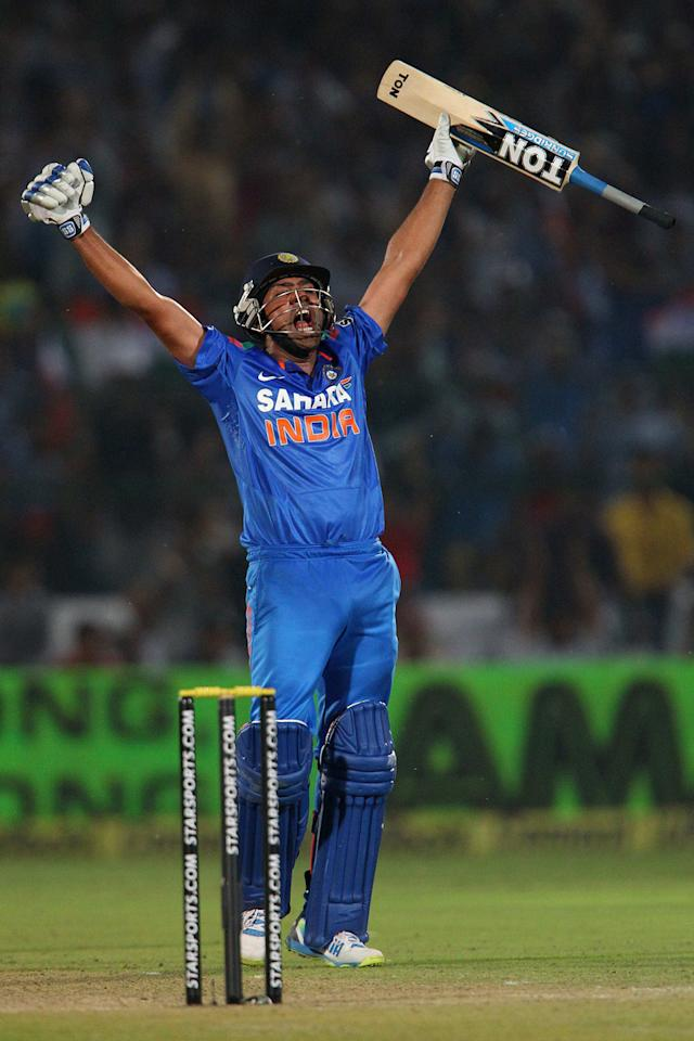 Rohit Sharma of India celebrates his century during the 2nd One Day International (ODI) match in the Star Sports Series between India and Australia held at the Sawai Mansingh Stadium in Jaipur on the 16th October 2013