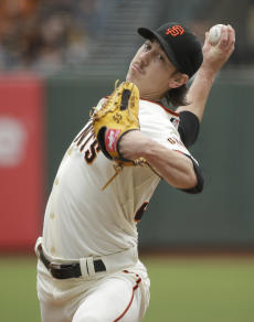 Tim Lincecum throws a first-inning pitch against the Padres. (AP)