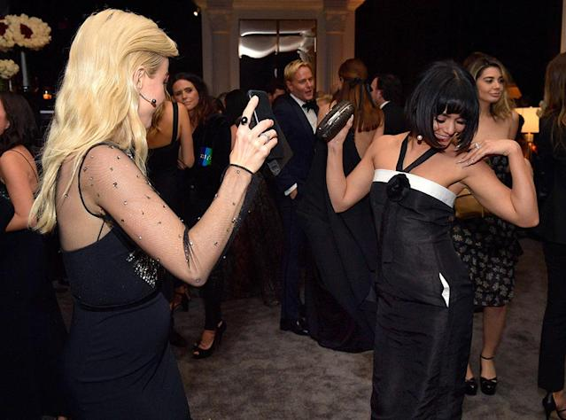 <p>Dance off! Julianne Hough and Vanessa Hudgens busted a move at the InStyle and Warner Bros. party. (Photo: Matt Winkelmeyer/Getty Images for InStyle) </p>