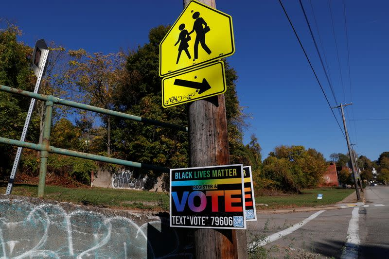 A Black Lives Matter sign urging people to vote hangs from a pole, amid the coronavirus disease (COVID-19) pandemic, in Pittsburgh, Pennsylvania