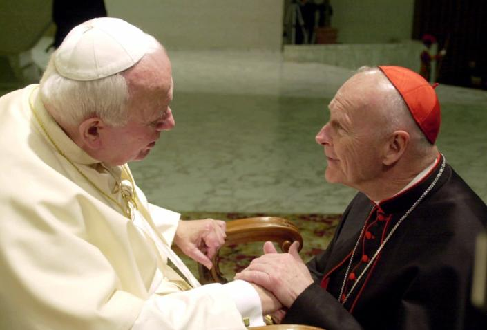 FILE - In this Feb. 23, 2001 file photo, U.S. Cardinal Theodore Edgar McCarrick, archbishop of Washington, D.C., shakes hands with Pope John Paul II during the General Audience with the newly appointed cardinals in the Paul VI hall at the Vatican. McCarrick was one of the three Americans on a record list of 44 new cardinals who were elevated in a ceremony at the Vatican on Feb. 21, 2001. (AP Photo/Massimo Sambucetti, File)