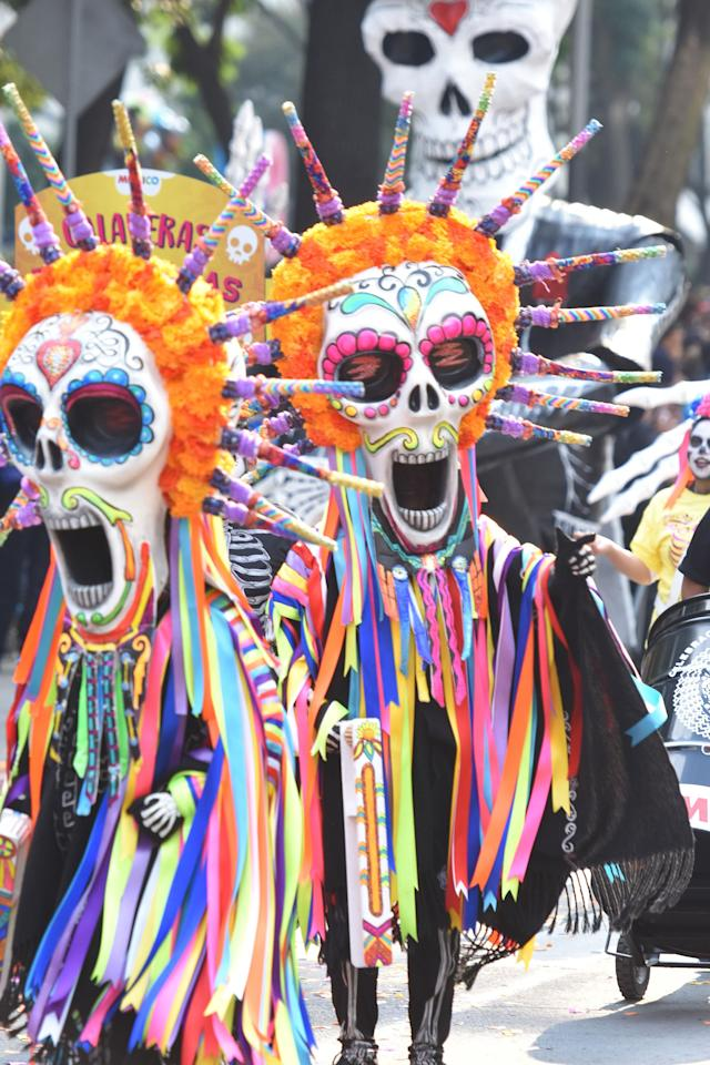<p>People are seen participate during the traditional Skulls Parade as part of Day of the Dead celebrations at Reforma Avenue on Oct. 28, 2017 in Mexico City, Mexico (Photo: Carlos Tischler/NurPhoto via Getty Images) </p>