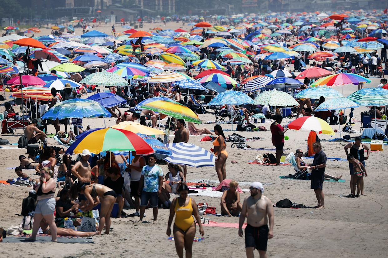 Large crowds visit the beach at Coney Island in Brooklyn on July 19, 2020, in New York City. Much of the East Coast is experiencing usually warm weather with high's in the 90's and a heat index that makes it feel over 100 degrees.
