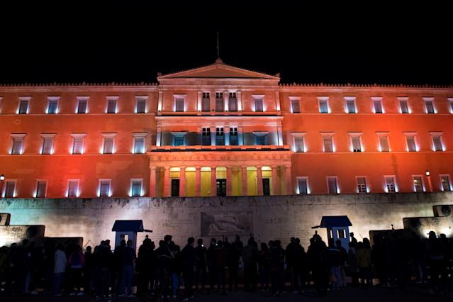 <p>The Greek parliament is illuminated in orange for the International Day for the Elimination of Violence Against Women, on Nov. 25, 2017 in Athens. (Photo: Angelos Tzortzinis/AFP/Getty Images) </p>