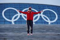 FILE PHOTO: Team Canada women's ice hockey player and Canadian flag bearer Wickenheiser poses in front of the Olympic rings at Bolshoy Ice Dome ahead of the 2014 Sochi Winter Olympics