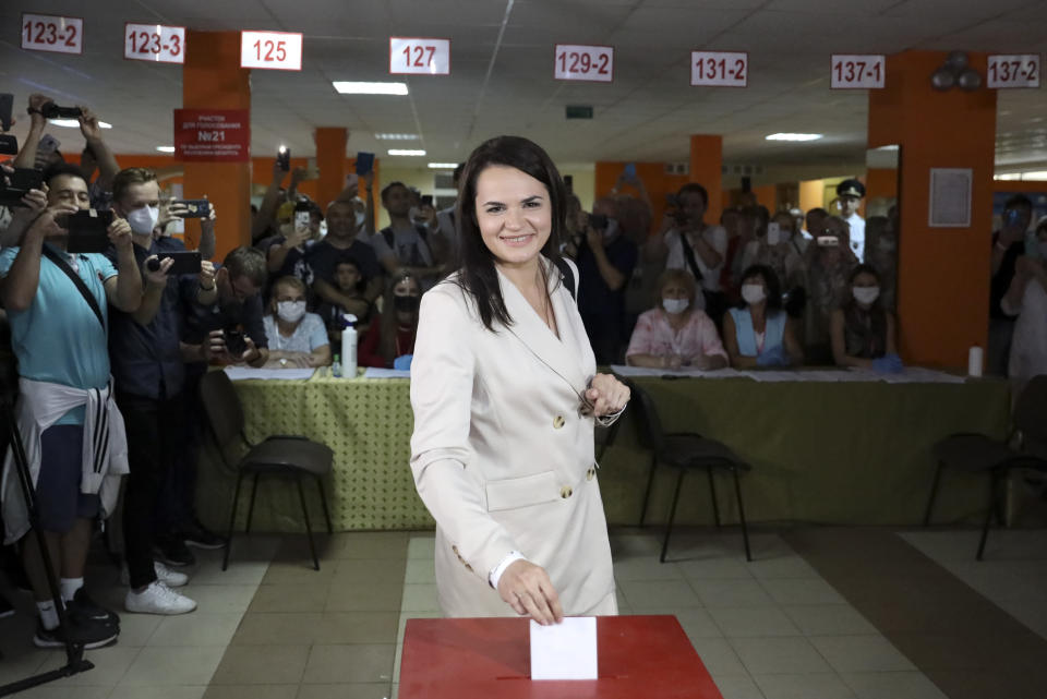 FILE - In this Sunday, Aug. 9, 2020 file photo, Sviatlana Tsikhanouskaya, candidate for the presidential elections, casts her ballot at a polling station during the presidential election in Minsk, Belarus. Belarus President Alexander Lukashenko has relied on massive arrests and intimidation tactics to hold on to power despite nearly three months of protests sparked by his re-election to a sixth term, but continuing protests have cast an unprecedented challenge to his 26-year rule. (AP Photo, File)